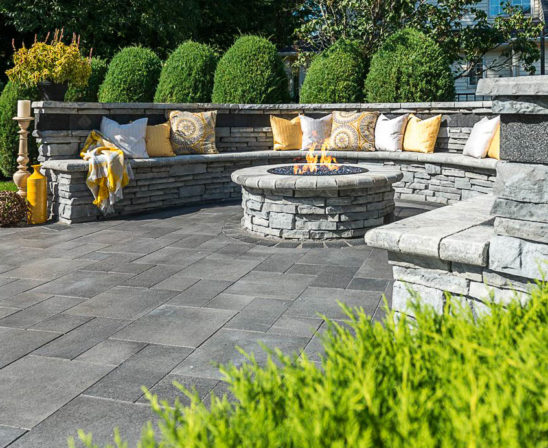 unilock umbriano pavers in midnight sky with rivercrest coastal slate stone for natural bench and wall