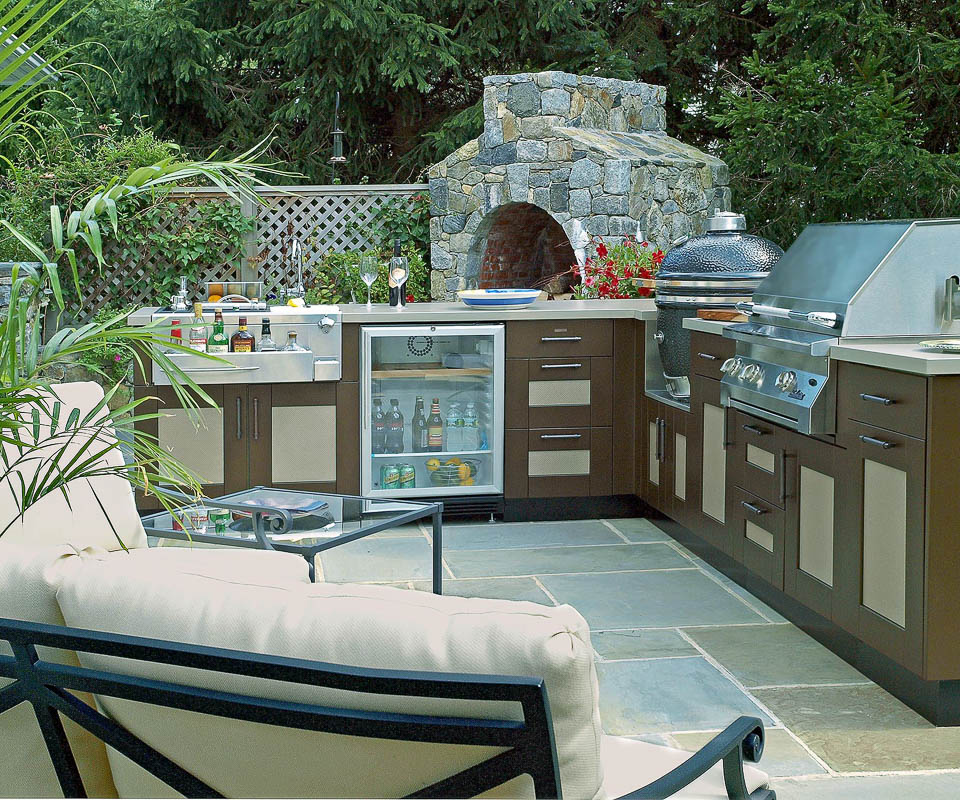 outdoor kitchen with big green egg built in, stone pizza oven