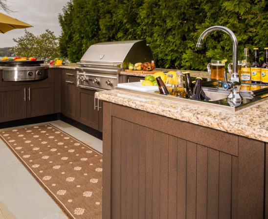 danver outdoor kitchen with sink, range, grill and granite counter tops