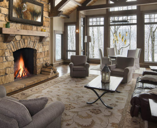 superior clay rumford fireplace in living room with natural stone feel