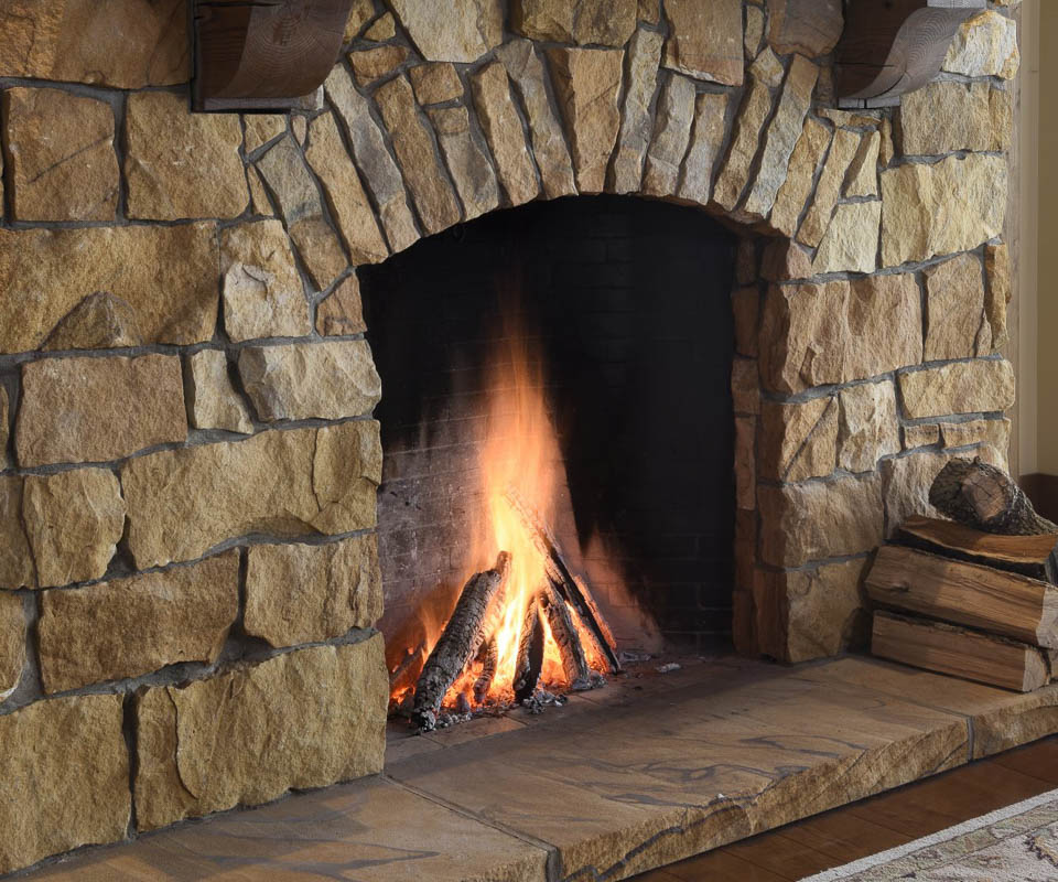 superior clay rumford fireplace with natural stone feel