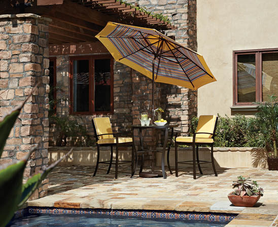 treasure garden umbrella with striped fabric through umbrella hole in bar height table