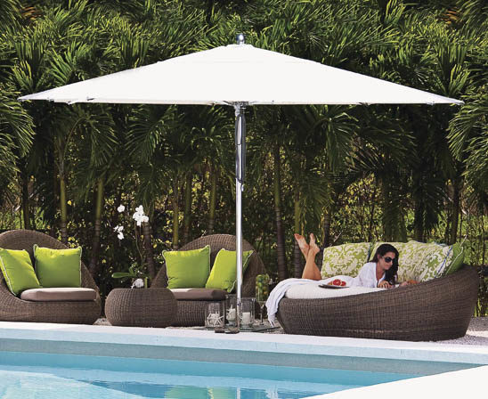 tuuci 10 foot hexagon umbrella in white by pool with wicker furniture