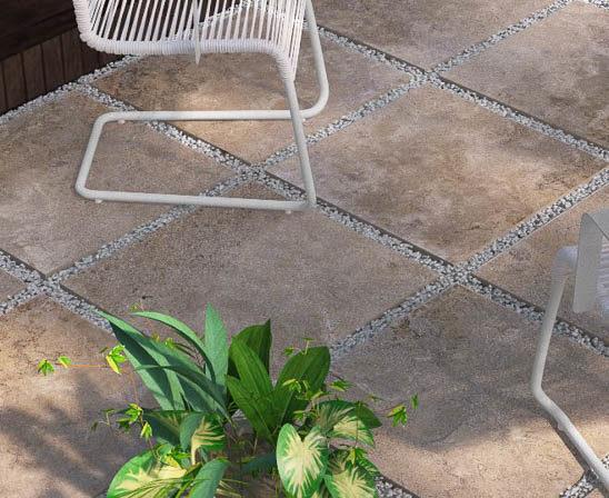 unilock's landscape porcelain tile in travstone noce