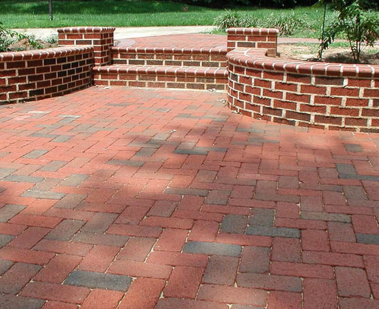 pine hall rumbled full range brick paver patio with seat wall