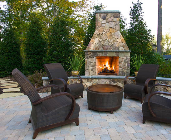 isokern outdoor fireplace with outdoor living furniture on brick patio