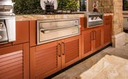 danver outdoor kitchen with louvered doors in brown wood grain finish