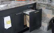 brown jordan outdoor kitchen storage doors and trash drawer with sparkly gray stone backsplash