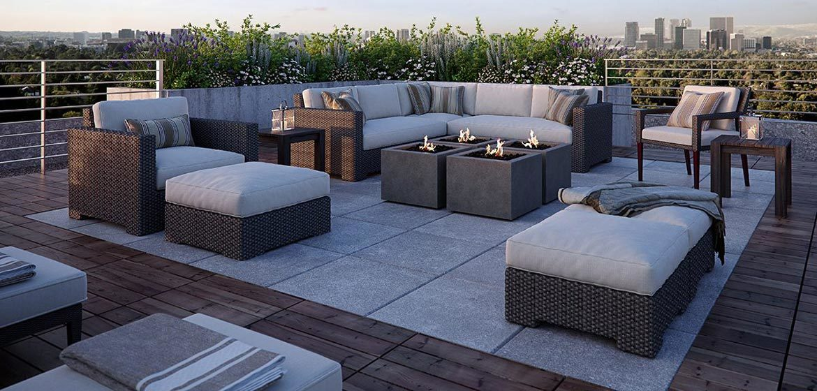 eldorado outdoor bloc fire bowl group on rooftop deck with wicker furniture and city skyline