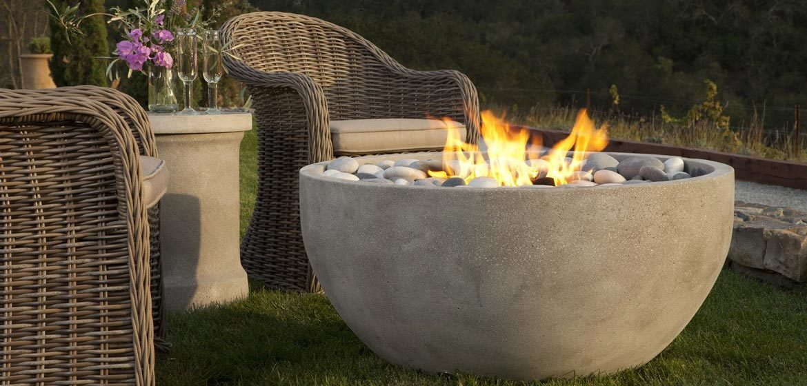eldorado outdoor infinite fire bowl near bocce court with wicker seating closeup