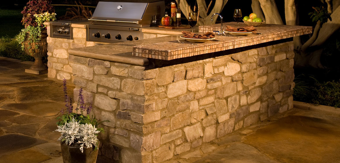 eldorado outdoor kitchen with built in grill and tile top cantilever bar
