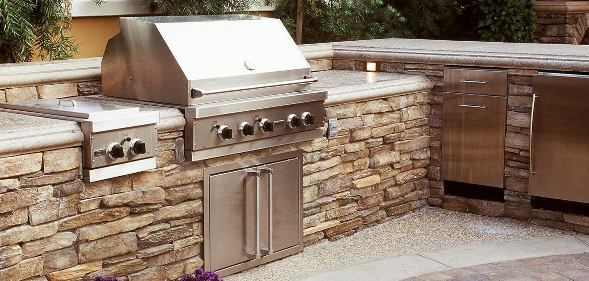eldorado outdoor kitchen with stackstone riverstone veneer and built in grill