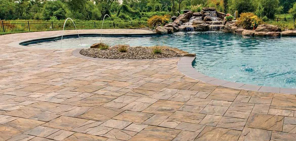 ep henry chiseled stone slate green pool deck with boulder waterfall