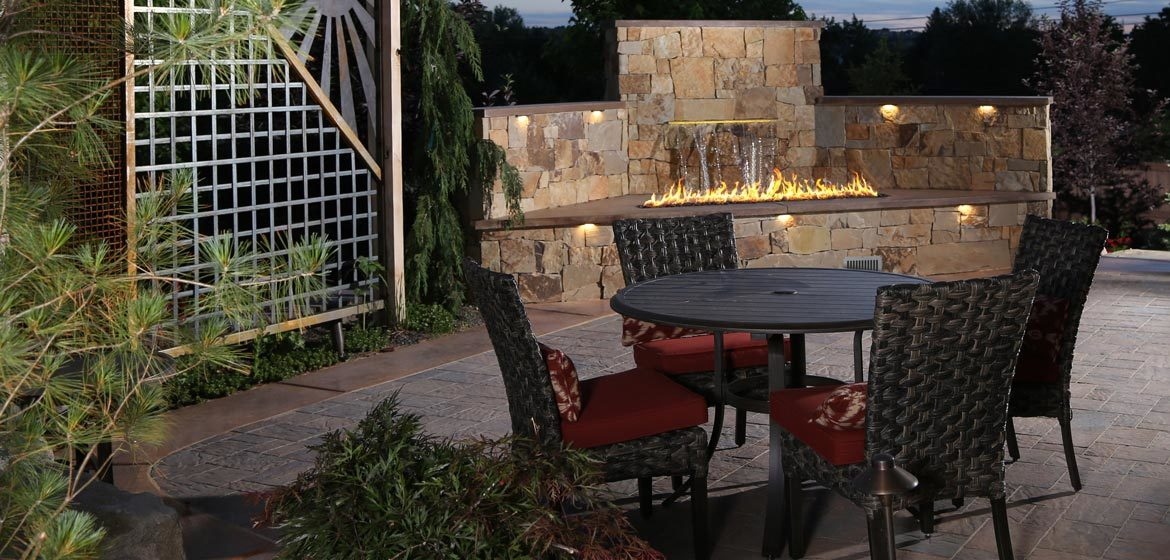 firegear outdoors l-series linear burner on concrete paver patio with cantilever umbrella and wicker outdoor dining furniture