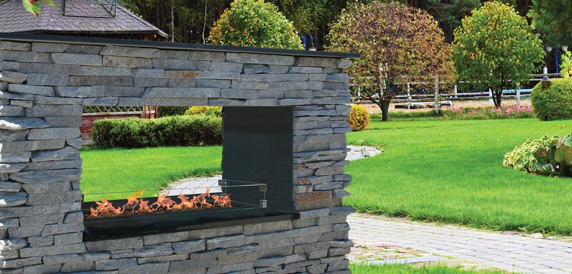 firegear outdoors key west natural gas or propane see through outdoor fireplace with natural stone veneer