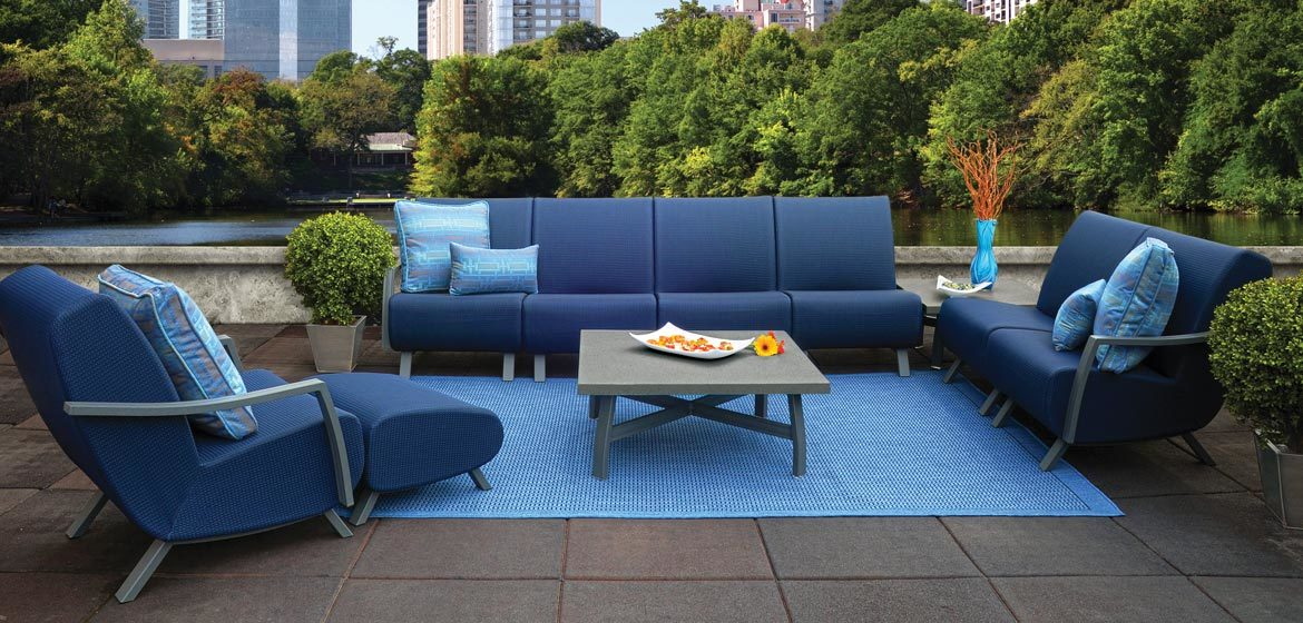 Homecrest Airo2 outdoor sectional sofa on rooftop patio with city skyline