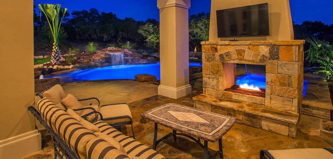 isokern see through outdoor fireplace interior view on flagstone patio with wrought iron sofa