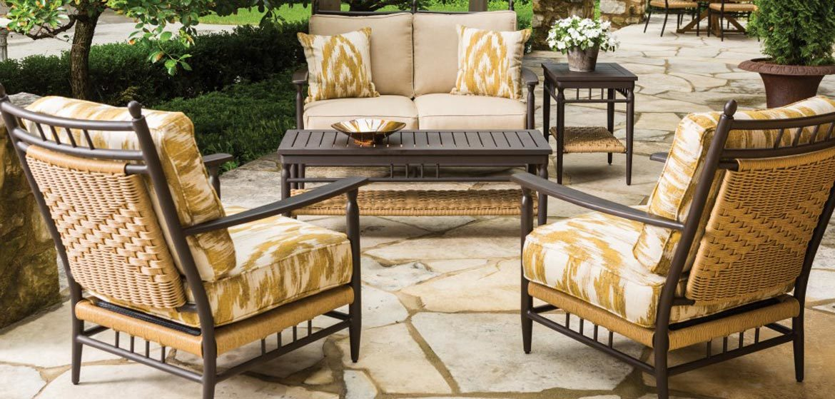 Lloyd Flanders Low Country outdoor cushion seating with love seat and lounge chairs on irregular flagstone patio