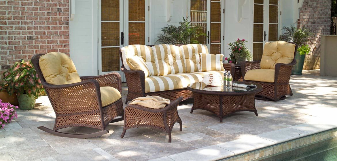 Lloyd Flanders Grand Traverse all weather wicker sofa and swivel rocker on travertine pool deck