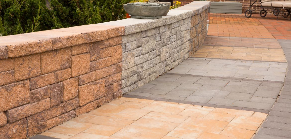 outdoor showroom with built in samples of ep henry concrete pavers and retaining wall block