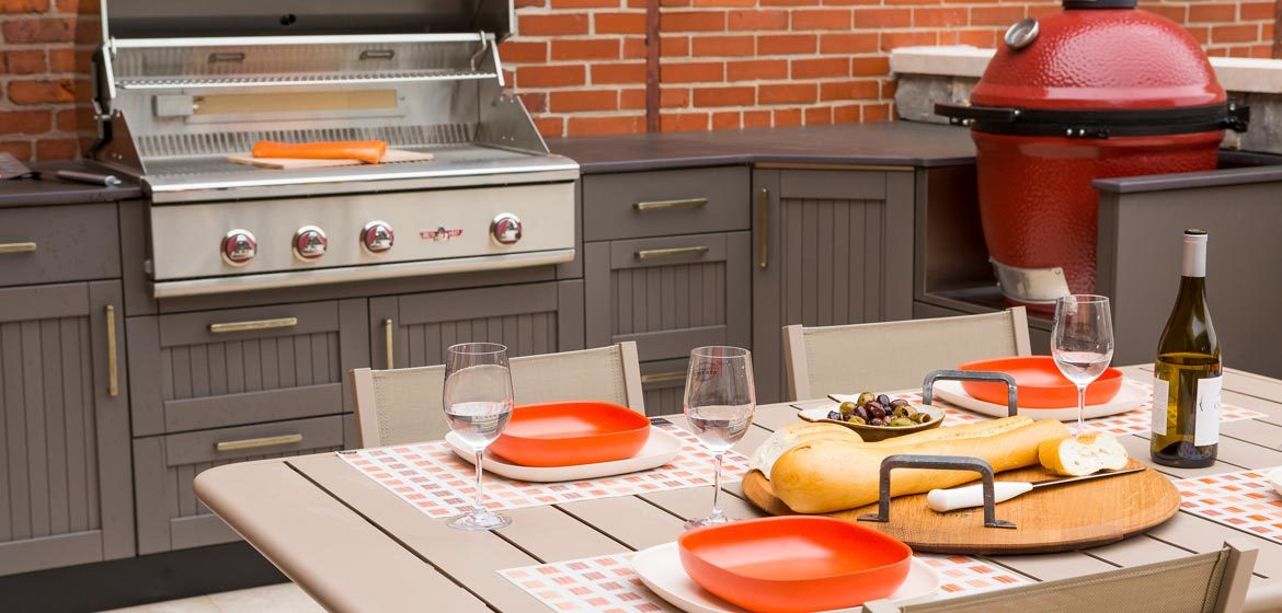 penn stone outdoor kitchen display with danver outdoor kitchen and delta heat grill and kamado joe ceramic grill and dekton countertop