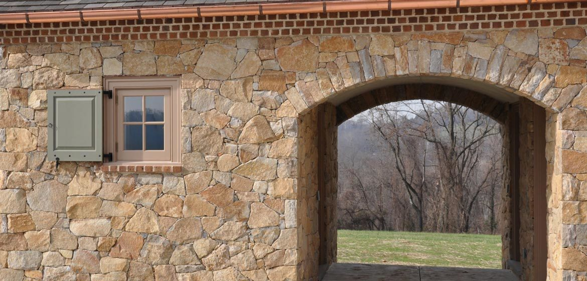 rolling rock building stone brookfield buff natural thin stone veneer barn breezeway