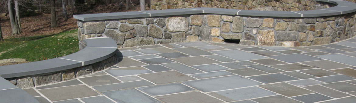 thermalled pennsylvania bluestone mortared in with natural landscape stone seat wall and custom fabricated bluestone coping