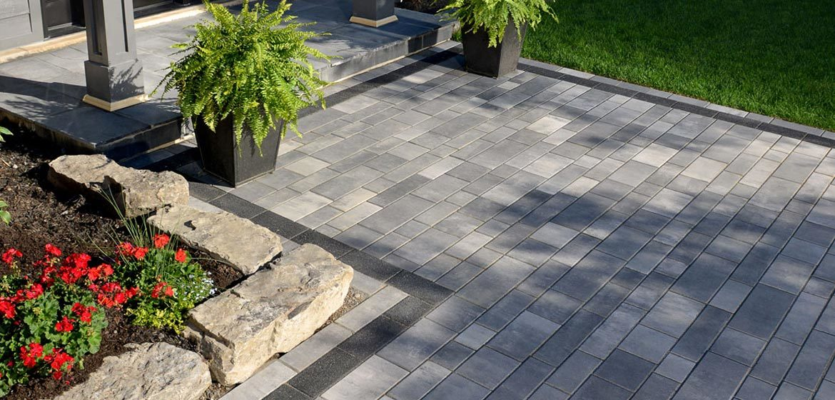 unilock artline concrete paver walkway and entrance with series border