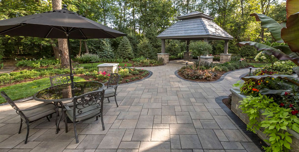 unilock beacon hill flagstone almond grove in beautiful backyard setting with outdoor furniture and pergola
