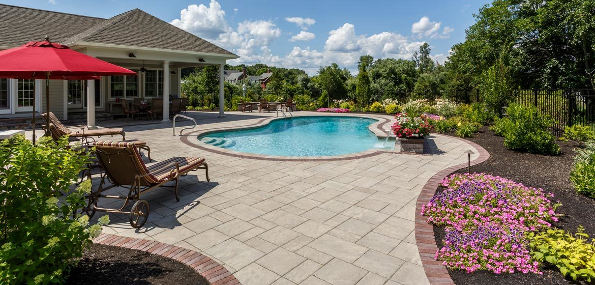unilock beacon hill flagstone concrete paver pool deck with copthorne border