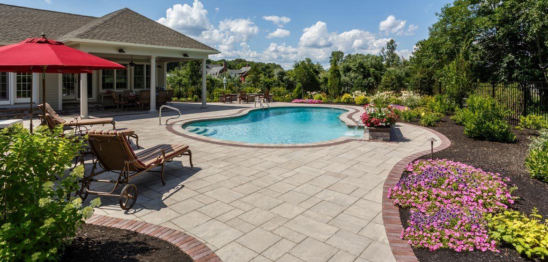 unilock beacon hill flagstone concrete paver pool deck with copthorne border