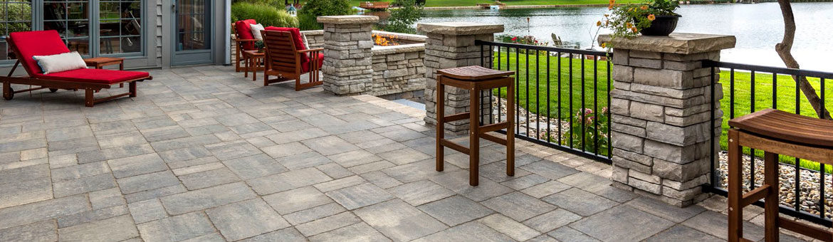 unilock bristol valley concrete paver patio with rivercrest wall columns and retaining wall