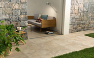 unilock caesar porcelain landscape tile on an outdoor patio adjacent to an interior space