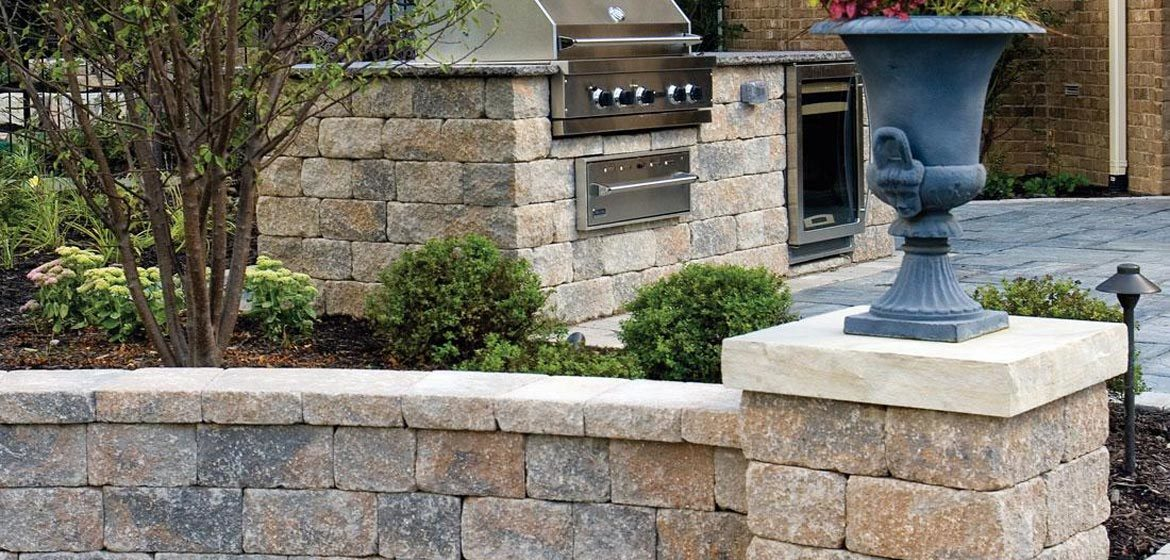 unilock estate wall seat wall and outdoor kitchen with grill
