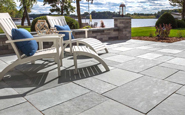 unilock natural stone flagstone winter mist with adirondack chairs