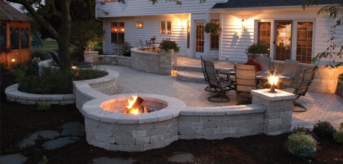 unilock brussels patio with built in round fire pit