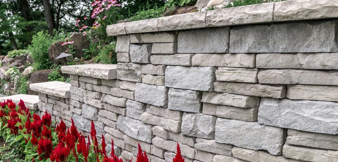 unilock rivercrest buff and coastal slate retaining wall