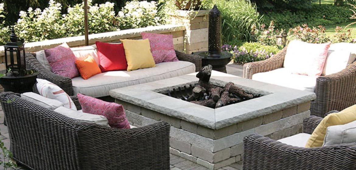 unilock brussels square fire pit with ledgestone coping and all weather wicker outdoor furniture