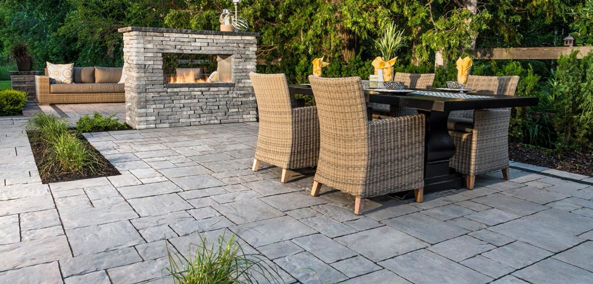 unilock thornbury almond grove concrete paver patio and rivercrest linear outdoor fireplace