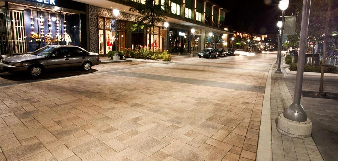 unilock umbriano concrete paver street downtown at night