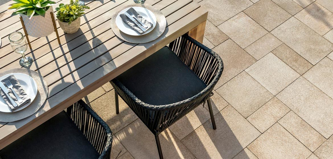 unilock umbriano concrete paver patio summer wheat with teak dining table