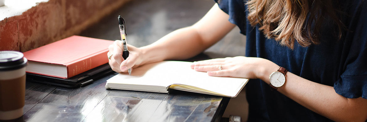 woman creating patio plan in notebook