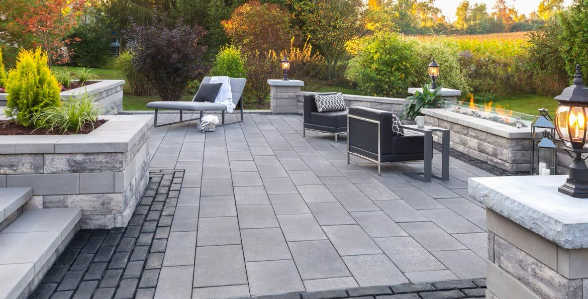 plan your fall hardscaping project featuring unilock patio pavers and walls