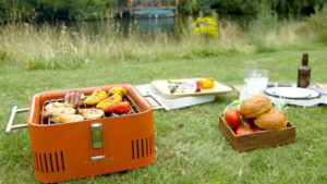 the everdure cube is a portable charcoal grill that is perfect for tailgating, picnicking or camping